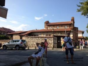 За тем забором православный храм.